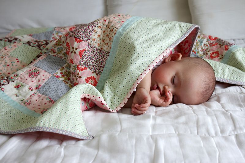 sleeping babe under the Mint and Sorbet quilt, nanaCompany