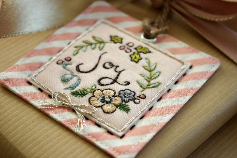"close up, handmade embroidered ""Joy"" tag by nanaCompany, J_2752"